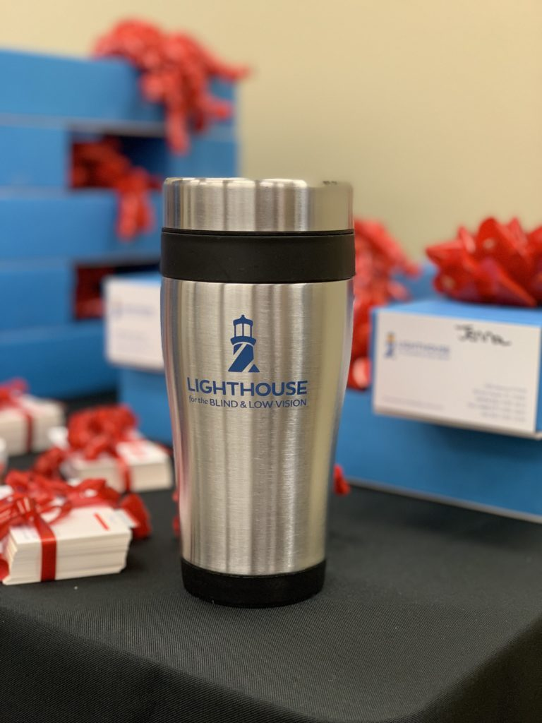 Branded travel mugs with the new Lighthouse for the Blind & Low Vision logo Click to Enlarge